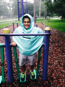 Playing at the park wearing Roo Rain Gear rainwear made from RPET