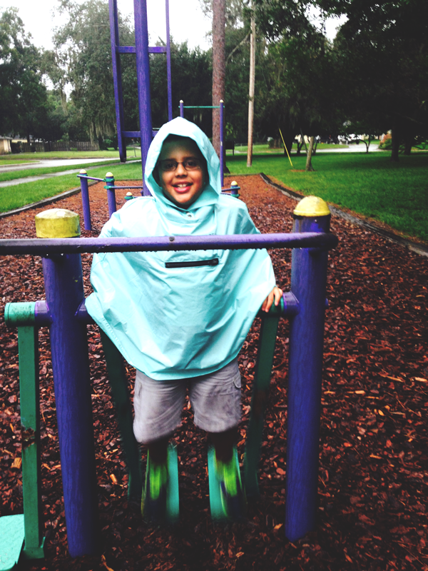 Playing at the park in Roo Rain Gear rainwear made from RPET