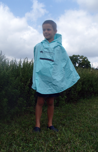 Kid Wearing Roo Rain Gear Waterproog Poncho on a hike in New Jersey