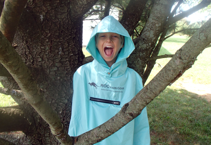 Kid wearing Roo Rain Gear Waterproof poncho on a hike in New Jersey